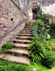 HDR of a stone staircase attached at a ancient ruin
