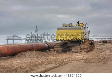 HDR of an Excavator on the beach of Scheveningen NL