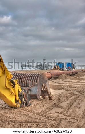 HDR of an Excavator on the beach of Scheveningen NL - stock photo