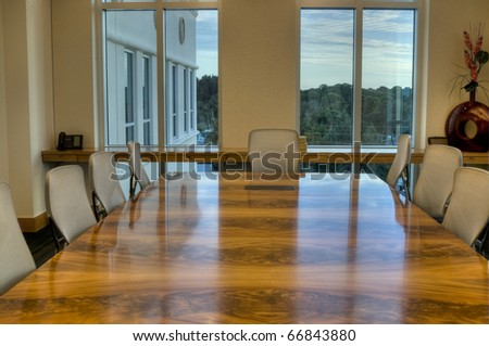 HDR of Office Conference Room with Windows at Sunset.