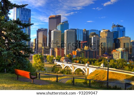 HDR Park bench overlooking Skyscrapers of Calgary, Alberta, Canada