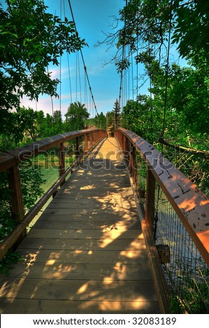 HDR Photo of a Suspension Bridge Over a River