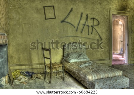 HDR photo of bed in derelict house. Graffiti against wall