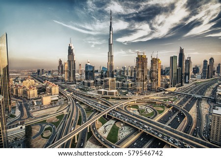 HDR photo of Dubai skyline with beautiful city close to it's busiest highway on traffic