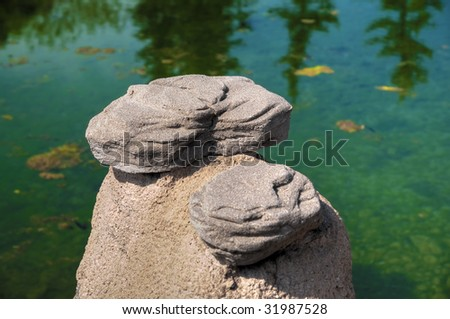 HDR photo of rock formation over a natural river. - stock photo