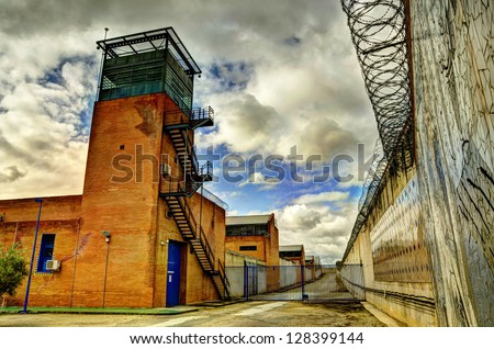 HDR prison and Barbed wire. - stock photo