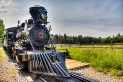 HDR rendering of a vintage locomotive steam engine with copy space.