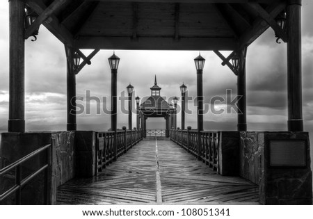 HDR shot of a pier in black and white
