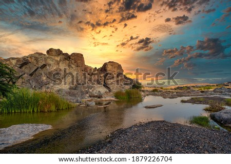 HDR sunset Landscape of Oman. wadi al khoud muscat Oman. Reflection view of Cloud and rock waterfall.