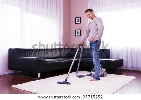 He cleaned the carpet, vacuum cleaner.