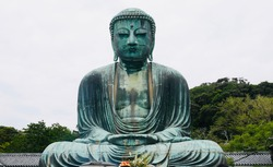 he Great Buddha of Kamakura, a monumental outdoor bronze statue of Amitābha, which is one of the most famous icons of Japan.