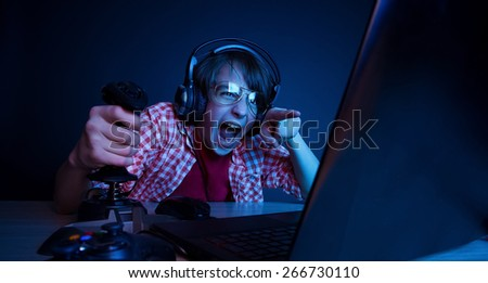 He had revenge in video games. In blue light of monitor emotional kid play computer games online.