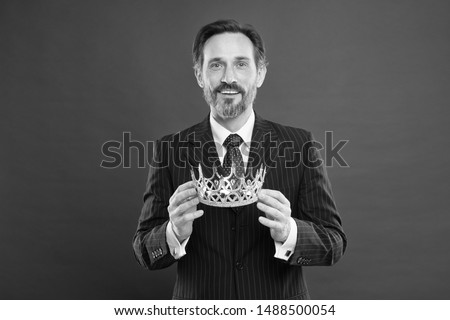 He is a big boss here. The old man or big boss. Proud boss. Big boss holding jewelry crown on red background. Mature businessman or director with reward. Making a big deal. #1488500054