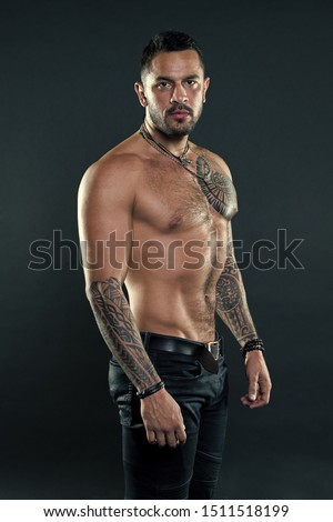 He is madly keen on sport. Hispanic man with muscular torso. Muscular man with tattoo. Sport and health care. Always have good health.