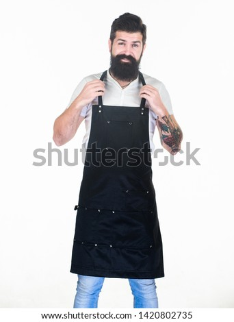 He is the best barber. Bearded man wearing barber apron. Hipster in work apron with multiple pockets. Hair stylist in barber shop. Barbershop or hairdressing salon.