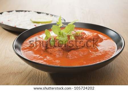 he most popular curry in the UK, chicken tikka masala, with rice.