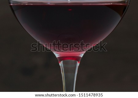 He poured a glass of red wine close-up #1511478935