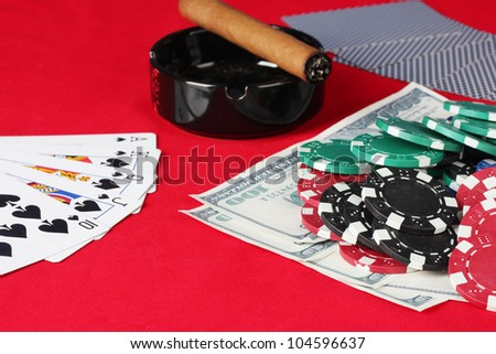 he red poker table with a combination of royal flush