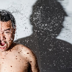He's a refreshing splash satisfy of water . Modern asian man happy at last of water splash