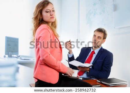 Head and secretary talking in the office.\The secretary closed her eyes and holding a cup of coffee.\Head obesnyaet, she does not want to listen.