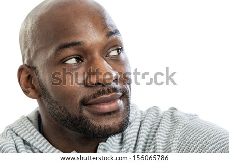 Head and shoulders portrait of a handsome late 20s black man looking over his shoulder isolated on white background