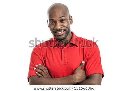 Head and shoulders studio portrait of a handsome black man in his late 20s smiling with arms crossed isolated on white