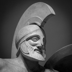 Head in helmet Greek ancient sculpture of warrior.