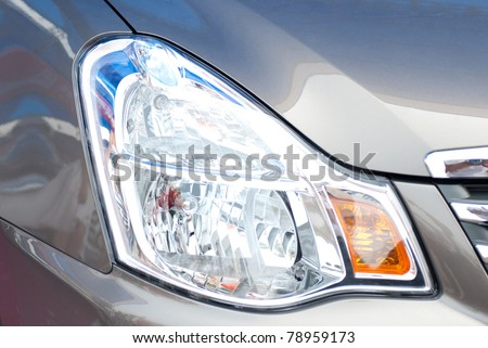 Head lights of a grey car