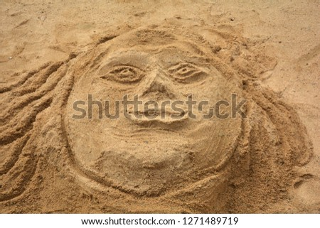 Head of a man made in sand, sand sculpture in close up