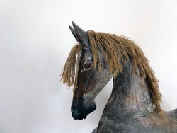 Head of an antique rocking horse with a fine wooden texture, Germany