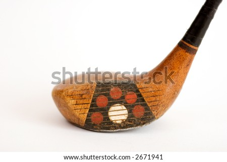 Head of antique golf driver against a white background with a shallow depth of field