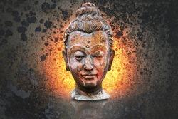 Head of buddha image isolated on art grunge background