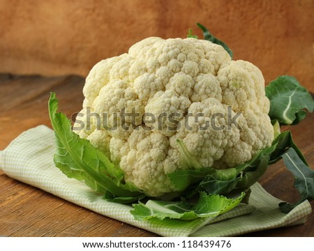 head of  cauliflower on a wooden table