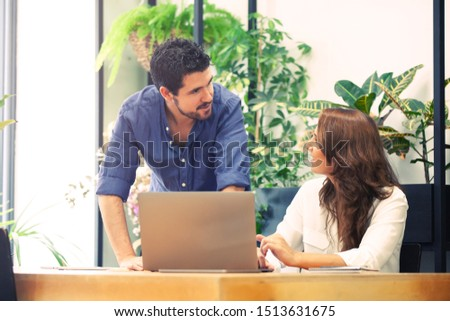 Head of department introducing the new coworker to the system in a hipster shared coworking space.  #1513631675