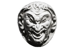 Head of laughing satyr carved in stone, black & white