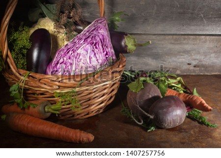 Head of red cabbage, eggplant,tomatoes, carrots, Basil-these vegetables are important in vegan And paleo diets. The concept of healthy, proper nutrition,. Diet, detox, cleansing