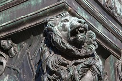 Head of the Bavarian lion at the Max Joseph monument in Munich heraldic animal and symbol of Bavaria for power strength prudence and justice