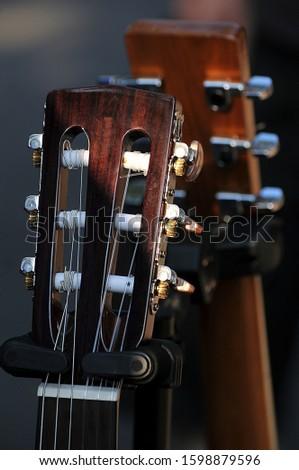 Head of the classical guitars,two six stringed guitar headstocks closeup