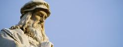 Head of the Leonardo da Vinci statue in Milan, the blue sky in the background