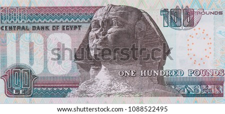 Head of the Sphinx statue, Mask of Pharaoh King Tutankhamoun. Portrait from Egypt 100 Pounds 2007 banknote. An Old paper banknotes, vintage retro. Famous ancient Banknotes. Egypt money. Collection.