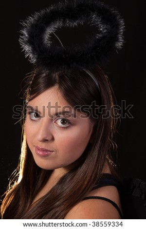 stock photo : Head of young brunette Hispanic teen girl with brown eyes and ...