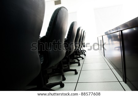 Head office boardroom with leather chairs.