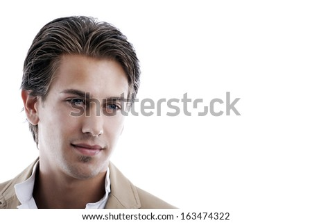 Head portrait of a handsome young man lost in thought staring thoughtfully downwards with a serious expression on white with copy space.