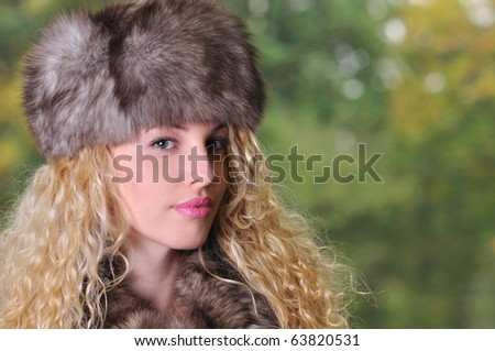 head portrait of beautiful young Caucasian woman with copy space on green