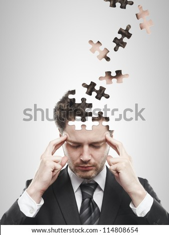 head puzzles businessman  on a white background