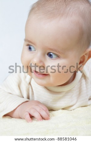 head shoot of cute baby with blue eyes and nice smile