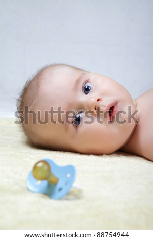 head shoot of cute baby with blue eyes and suprise look