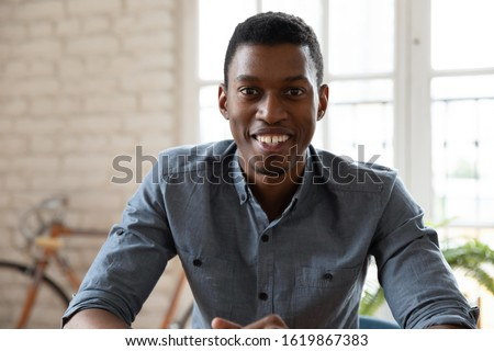 Head shot African American businessman using webcam, looking at camera and talking, working online, business coach mentor recording video, employee manager financial advisor consulting client