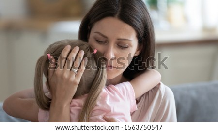 Head shot close up portrait compassionate young mother comforting little preschool daughter. Empathic upset 30s woman cuddling frustrated small kid girl. Children protection and support concept. Stock photo ©