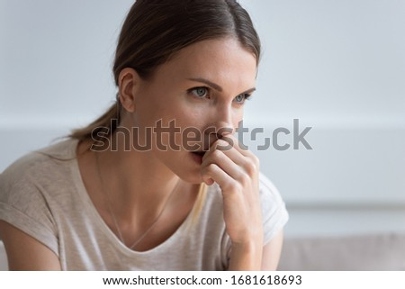 Head shot close up serious upset thoughtful young woman looking in distance, thinking about problems, pensive unhappy female making difficult decision, lost in thoughts, consider life troubles